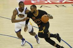 June 19, 2016; Oakland, CA, USA; Cleveland Cavaliers forward LeBron James (23) moves the ball against Golden State Warriors forward Harrison Barnes (40) in the second half in game seven of the NBA Finals at Oracle Arena. Mandatory Credit: Cary Edmondson-USA TODAY Sports