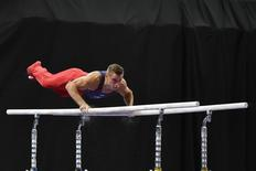 Jun 23, 2016; St. Louis, MO, USA; Sam Mikulak competes on the parallel bars during the 2016 USA Gymnastics Olympic Team Trials at Chaifetz Arena,.  Jasen Vinlove-USA TODAY Sports