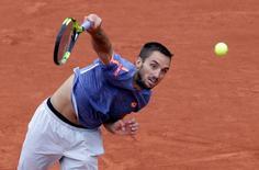 Tennis - French Open - Roland Garros - Viktor Troicki of Serbia v Stan Wawrinka of Switzerland - Paris, France - 29/05/16. Troicki serves.  REUTERS/Jacky Naegelen