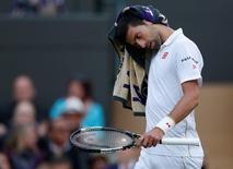 Britain Tennis - Wimbledon - All England Lawn Tennis & Croquet Club, Wimbledon, England - 1/7/16 Serbia's Novak Djokovic reacts during his match against USA's Sam Querrey REUTERS/Andrew Couldridge