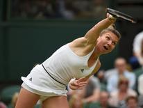 Britain Tennis - Wimbledon - All England Lawn Tennis & Croquet Club, Wimbledon, England - 2/7/16 Romania's Simona Halep in action against Holland's Kiki Bertens REUTERS/Toby Melville