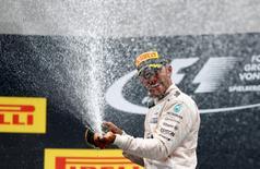 Formula One - Grand Prix of Austria - Spielberg, Austria - 3/7/16 -  Mercedes Formula One driver Lewis Hamilton of Britain sparys champagne as he celebrates victory. REUTERS/Dominic Ebenbichler