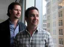 Online dating agency Ashley Madison's CEO Rob Segal (R) and president James Millership pose during an interview in Toronto, Ontario, Canada June 28, 2016. Picture taken June 28, 2016.  REUTERS/Chris Helgren