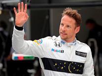 Formula One - Russian Grand Prix - Sochi, Russia - 30/4/16 - McLaren Honda Formula One driver Jenson Button of Britain waves after the qualifying session. REUTERS/Yuri Kochetkov