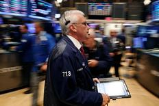 A trader works on the floor of the New York Stock Exchange (NYSE)  in New York, U.S., July 5, 2016.  REUTERS/Lucas Jackson