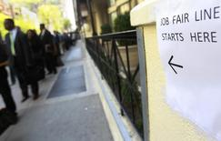 People wait in line to enter a job fair in New York in this April 18, 2012 file photo. REUTERS/Shannon Stapleton