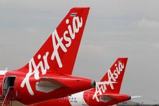 Air Asia planes prepare for take off at Don Mueang International Airport in Bangkok, Thailand, June 29, 2016.  REUTERS/Chaiwat Subprasom
