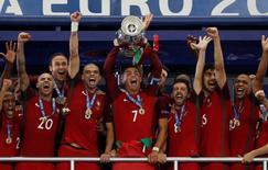 Football Soccer - Portugal v France - EURO 2016 - Final - Stade de France, Saint-Denis near Paris, France - 10/7/16 Portugal celebrates with the trophy after winning Euro 2016 REUTERS/Darren Staples Livepic