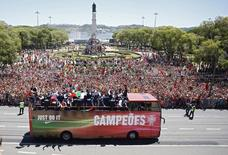 Portugal's winning EURO 2016 team ride in an open bus onn their return to Lisbon, Portugal, July 11, 2016.    REUTERS/Pedro Nunes