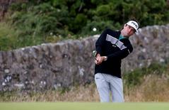 Golf - British Open - Practice Round - Royal Troon, Scotland, Britain - 11/07/2016  Bubba Watson of the U.S. chips onto the 11th green during practice  REUTERS/Craig Brough