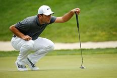 Jun 24, 2016; Bethesda, MD, USA; Francesco Molinari of Italy lines up a putt on the eleventh hole during the second round of the Quicken Loans National golf tournament. at Congressional Country Club - Blue Course. Geoff Burke-USA TODAY Sports