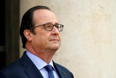 French President Francois Hollande waits for guests outside the Elysee Palace in Paris, France, July 11, 2016. REUTERS/Benoit Tessier