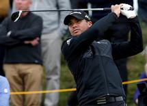 Golf - British Open - practice round - Royal Troon, Scotland, Britain - 12/07/2016.  Jason Day of Australia watches his tee shot on the tenth hole.  REUTERS/Craig Brough