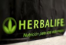 An Herbalife logo is shown on a poster at a clinic in the Mission District in San Francisco, California April 29, 2013.   REUTERS/Robert Galbraith/File Photo