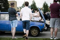 People gather as asylum seekers' abandoned cars are auctioned in Salla, northern Finland July 15, 2016. Lehtikuva/Jouni Porsanger/ via REUTERS