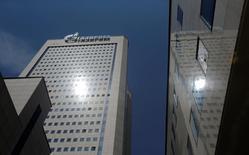 Центральный офис Газпрома в Москве. 30 июня 2016 года. Финансовая госкорпорация Внешэкономбанк продала акции и ADR Газпрома в размере 3,59 процента уставного капитала самой газовой монополии, сообщили ВЭБ и Газпром в пятницу. REUTERS/Maxim Shemetov