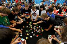 Competitors solve Rubik's cubes as they prepare for the Rubik's Cube European Championship in Prague, Czech Republic, July 17, 2016. REUTERS/David W Cerny