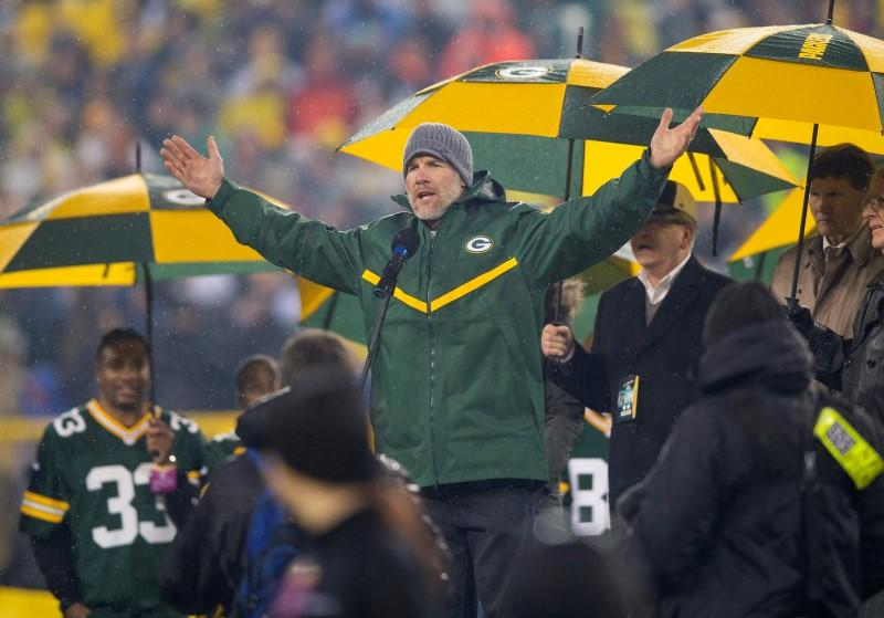 Hall of fame iron man favre almost flunked out by physical bay packers quarterback brett favre addresses the crowd during halftime of the nfl game against the chicago bears on thanksgiving at lambeau field voltagebd Images