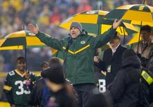 Nov 26, 2015; Green Bay, WI, USA; Former Green Bay Packers quarterback Brett Favre addresses the crowd during halftime of the NFL game against the Chicago Bears on Thanksgiving at Lambeau Field.  Jeff Hanisch-USA TODAY Sports
