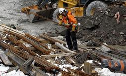 A worker carries building materials at a construction site in Ottawa, Canada, April 8, 2016. REUTERS/Chris Wattie