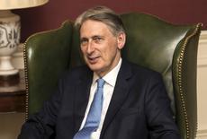 Le nouveau Chancelier de l'Echiquier Philip Hammond va faire ses débuts sur la scène internationale. Les retombées du Brexit et les craintes d'un regain de protectionnisme dans un monde dont la croissance économique patine figureront à l'ordre du jour de la réunion des grands argentiers du Groupe des Vingt (G20). /Photo prise le 14 juillet 2016/REUTERS/Carl Court/Pool