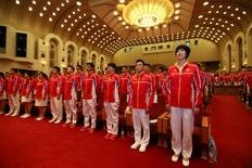 China's athletes for the 2016 Rio Olympics sing the Chinese national anthem during a gathering in Beijing, China, before going to Brazil,  July 18, 2016.  REUTERS/Stringer