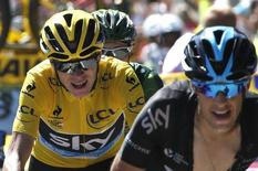 Team Sky rider Chris Froome of Britain (L), race leader's yellow jersey, grimaces as he cycles with team-mate Team Sky rider Richie Porte of Australia (R) during the 110.5-km (68.6 miles) 20th stage of the 102nd Tour de France cycling race from Modane to Alpe d'Huez in the French Alps mountains, France, July 25, 2015.       REUTERS/Eric Gaillard