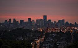 The downtown of Vancouver, British Columbia is pictured at sunset int his file photo dated July 31, 2013.   REUTERS/Andy Clark