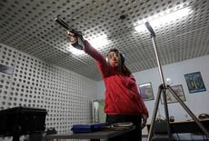 Georgian sports shooter Nino Salukvadze takes aim during a practice session in Tbilisi, March 12, 2012. REUTERS/David Mdzinarishvili
