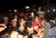 Riot police clash with demonstrators who had gathered in a show of support for gunmen holding several hostages in a police station in Yerevan, Armenia, July 20, 2016. Picture taken July 20, 2016.  Hrant Khachatryan/PAN Photo/Handout via REUTERS ATTENTION EDITORS - THIS IMAGE WAS PROVIDED BY A THIRD PARTY. EDITORIAL USE ONLY.