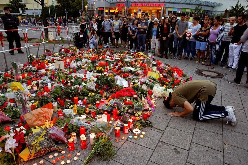 German officials urge close look at gun laws in wake of