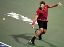 Jul 26, 2016; Toronto, Ontario, Canada;  Stan Wawrinka of Switzerland hits a shot against Mikhail Youzhny of Russia on day two of the Rogers Cup tennis tournament at Aviva Centre. Mandatory Credit: Dan Hamilton-USA TODAY Sports