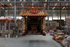A ready-made Chinese traditional temple is seen being lifted for delivery at the Chuanso factory that manufactures religious objects in Pingtung, Taiwan July 5, 2016. REUTERS/Tyrone Siu