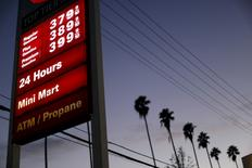 Regular unleaded petrol is seen priced at $3.79 per gallon ($1 per litre) at a 76 gas station in Los Angeles, California February 4, 2016. REUTERS/Mario Anzuoni