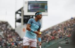 Tennis - French Open - Roland Garros -  Rafael Nadal of Spain vs Sam Groth of Australia Paris, France - 24/05/16. Rafael Nadal of Spain reacts.  REUTERS/Gonzalo Fuentes