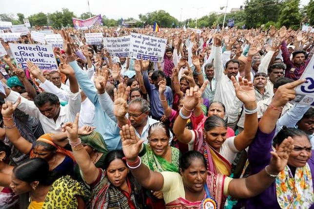 People shout slogans as they attend a protest rally against what they say are attacks on India's low-caste Dalit community in Ahmedabad, India, July 31, 2016. REUTERS/Amit Dave
