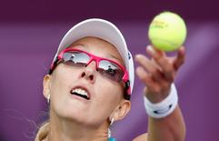 Anastasia Rodionova of Australia serves the ball to Agnieszka Radwanska of Poland during their women's match at the Qatar Open tennis tournament in Doha February 13, 2013. REUTERS/Fadi Al-Assaad