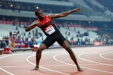 Jamaica's Usain Bolt celebrates after winning the Men's 200m Reuters / Eddie KeoghLivepic