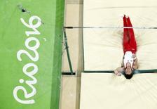 2016 Rio Olympics - Artistic Gymnastics - Preliminary - Men's Qualification - Subdivisions - Rio Olympic Arena - Rio de Janeiro, Brazil - 06/08/2016 Kohei Uchimura (JPN) of Japan falls during the men's qualifications for the horizontal bar.  REUTERS/Athit Perawongmetha