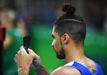 2016 Rio Olympics - Gymnastics training - Rio Olympic Arena - Rio de Janeiro, Brazil - 03/08/2016. Louis Smith (GBR) of United Kingdom trains. REUTERS/Dylan Martinez
