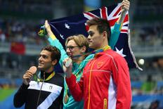 Aug 6, 2016; Rio de Janeiro, Brazil; Gabriele Detti (ITA), left, Mack Horton (AUS), middle, and Yang Sun (CHN) after the men's 400m freestyle final during the Rio 2016 Summer Olympic Games at Olympic Aquatics Stadium. Mandatory Credit: Erich Schlegel-USA TODAY Sports