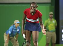 2016 Rio Olympics - Tennis - Preliminary - Women's Singles First Round - Olympic Tennis Centre - Rio de Janeiro, Brazil - 06/08/2016. Venus Williams (USA) of USA reacts during her match against Kirsten Flipkens (BEL) of Belgium.  REUTERS/Kevin Lamarque