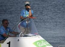2016 Rio Olympics - Rowing - Repechage - Men's Single Sculls Repechages - Lagoa Stadium - Rio De Janeiro, Brazil - 07/08/2016. Race officials stand by in a boat shortly after competition was postponed due to high winds. REUTERS/Carlos Barria