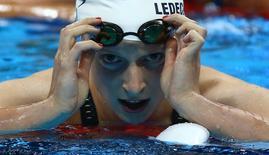 2016 Rio Olympics - Swimming - Preliminary - Women's 200m Freestyle - Heats - Olympic Aquatics Stadium - Rio de Janeiro, Brazil - 08/08/2016. Katie Ledecky (USA) of USA reacts.   REUTERS/Michael Dalder