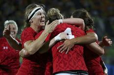 2016 Rio Olympics - Rugby - Women's Bronze Medal Match Canada v Britain  - Deodoro Stadium - Rio de Janeiro, Brazil - 08/08/2016.  Kelly Russell (CAN) of Canada (4) celebrates with teammates after scoring. REUTERS/Alessandro Bianchi