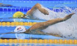 2016 Rio Olympics - Swimming - Preliminary - Men's 100m Freestyle - Heats - Olympic Aquatics Stadium - Rio de Janeiro, Brazil - 09/08/2016. Nathan Adrian (USA) of USA and Kyle Chalmers (AUS) of Australia compete.   REUTERS/Dominic Ebenbichler