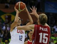 2016 Rio Olympics - Basketball - Preliminary - Women's Preliminary Round Group B USA v Serbia - Youth Arena - Rio de Janeiro, Brazil - 10/08/2016 Diana Taurasi (USA) of USA and Danielle Page (SRB) of Serbia compete. REUTERS/Sergio Moraes