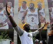Cleveland Cavaliers Lebron James celebrates with the crowd during a parade to celebrate winning the 2016 NBA Championship in downtown Cleveland, Ohio, U.S. June 22, 2016.  REUTERS/Aaron Josefczyk