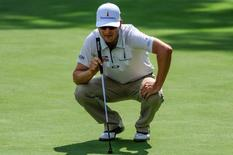 Aug 11, 2016; Silvis, IL, USA; Zach Johnson lines up his putt on the tenth hole during the first round at TPC Deere Run. Johnson was an early leader at five under par.  Mandatory Credit: Jeffrey Becker