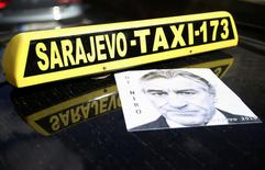"""Poster of Robert De Niro is seen on the cab in tribute to the actor who will open the city's film festival on Friday with a screening of """"Taxi Driver"""" in Sarajevo, Bosnia and Herzegovina, August 12, 2016. REUTERS/Dado Ruvic"""
